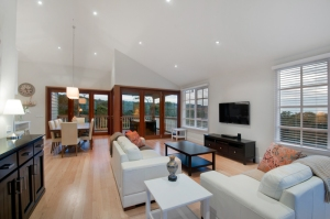 Open plan living in architect designed home by Blint Design + Construction.