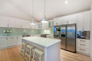 Beautiful designer kitchen with modern stainless steel appliances throughout. Build with Blint, you'll be glad you did.