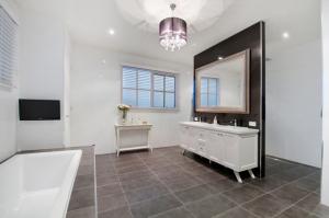 Stylish designer bathroom with modern fittings by Blints in McKinnon