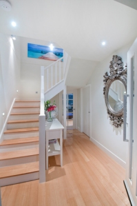 Modern entranceway with staircase leading into house.